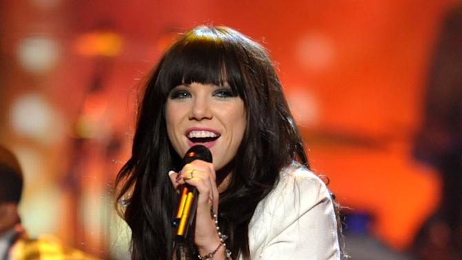 "FILE - This Nov. 18, 2012 file photo shows Carly Rae Jepsen performing ""This Kiss"" at the 40th Annual American Music Awards in Los Angeles. Jepsen had the song of the year with ""Call Me Maybe"" _ and so it was also tops on iTunes. Following behind was Goyte's ""Somebody That I Used To Know,"" fun.'s ""We Are Young,"" Maroon 5's ""Payphone"" with Wiz Khalifa and Nicki Minah's ""Starships.""  (Photo by John Shearer/Invision/AP)"