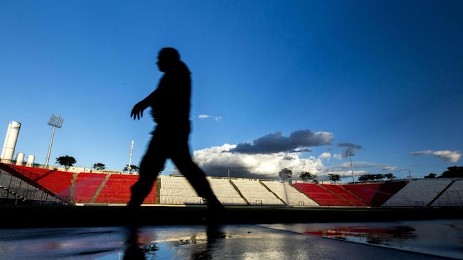 In this Feb. 4, 2014 photo, a security guard patrols the Arena do Jacare stadium in Sete Lagoas, Brazil. Uruguay's national soccer team will practice at the stadium during the 2014 FIFA World Cup tournament in Brazil