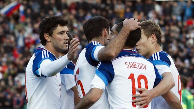 Russia's from left: Yury Zhirkov, Roman Shirokov, Alexander Samedov and Alexander Kokorin celebrate a goal during international friendly soccer match against Armenia in Krasnodar, Russia, Wednesday, March 5, 2014. Russia won 2-0