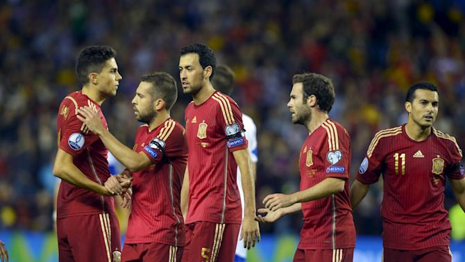 Spain's players celebrate a goal during their Euro 2016 Group C qualification soccer match against Luxembourg in Logrono