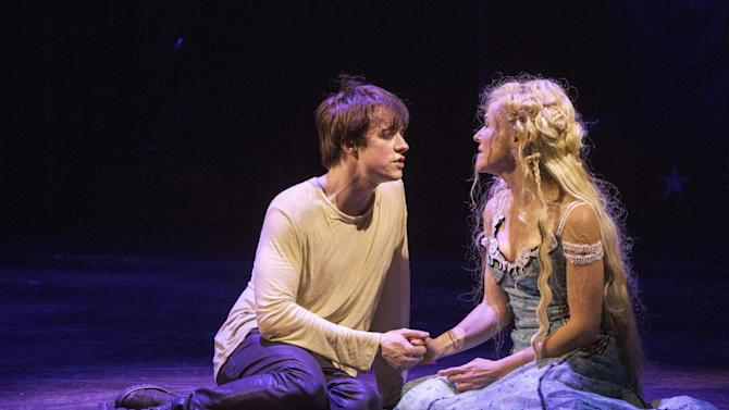 "This undated publicity photo provided by American Repertory Theater shows Matthew James Thomas, left, as Pippin and Rachel Bay Jones as Catherine in a production of ""Pippin,"" at the American Repertory Theater in Cambridge, Mass. Producers of the Diane Paulus-led revival that is currently playing at the American Repertory Theater outside Boston said late Thursday that ""Pippin"" will transfer to the Music Box Theatre this spring. Performances begin March 23 with an official opening on April 25. (AP Photo/American Repertory Theater, Michael J. Lutch)"