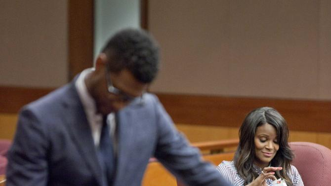 "Hip-hop artist Usher Raymond, left, stands in court during a brief recess in a legal battle with his ex-wife Tameka Foster Raymond, right, in a custody fight involving their two sons Tuesday, May 22, 2012, in Atlanta. The 33-year-old singer testified in court on Tuesday that Foster Raymond spit at and tried to fight his girlfriend during one nasty visit. He said his ex-wife hit him during the dispute, but that he didn't press charges because ""I didn't want the boys to know that their father put their mother in jail.""  The two were married in 2007 and divorced two years later. (AP Photo/David Goldman)"
