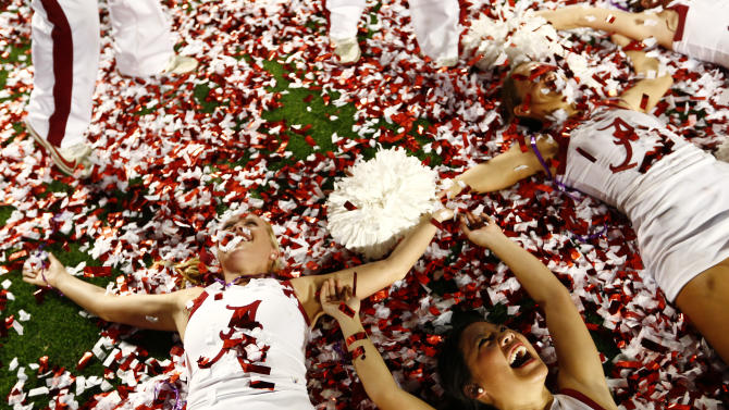 Alabama cheerleaders celebrate after their team defeated Notre Dame in their NCAA BCS National Championship college football game in Miami