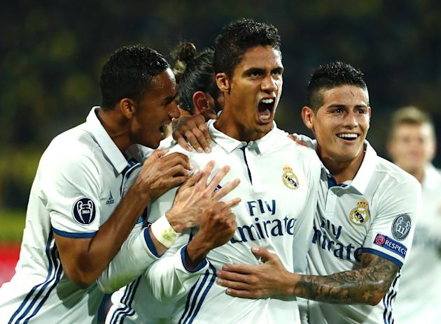 Real Madrid's French defender Raphael Varane (C) celebrates after scoring during the UEFA Champions League first leg match against Borussia Dortmund