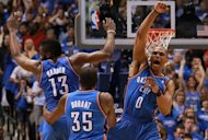 (From L) James Harden, Kevin Durant and Russell Westbrook of the Oklahoma City Thunder celebrate after scoring with 10 seconds left against the Dallas Mavericks during Game Four of the Western Conference Quarterfinals in the 2012 NBA Playoffs, at American Airlines Center, on May 5, in Dallas, Texas. Oklahoma won 103-97 and took the series 4-0