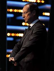 """France's Socialist Party (PS) candidate for the 2012 presidential election Francois Hollande wait to take part in the TV show """"Le grand journal"""" on a set of French TV Canal+"""