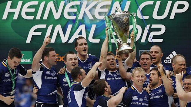 Leinster's rugby players celebrate with the trophy after they won the Heineken Cup final rugby match against Ulster at Twickenham Stadium in London (Reuters)