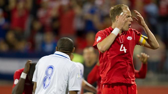Kevin McKenna of Canada reacts after na