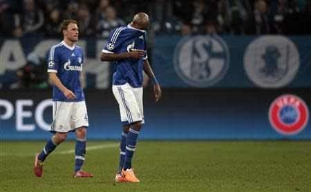 Schalke 04's Hoewedes and Santana react during their Champions League soccer match against Real Madrid in Gelsenkirchen
