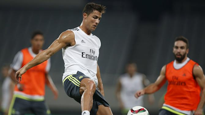 Cristiano Ronaldo of Real Madrid fights for the ball during a training session ahead of a friendly soccer match against AC Milan in Shanghai