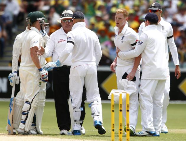 The umpire intervenes to stop an argument between Australia's Clarke and Haddin with England's Stokes during the second day of the second Ashes test cricket match in Adelaide