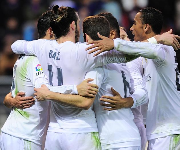 Real Madrid players celebrate their second goal during the Spanish league football match SD Eibar vs Real Madrid CF at the Ipurua stadium in Eibar on November 29, 2015