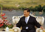 Chinese leader-in-waiting Xi Jinping, pictured here on September 19, has told a visiting Philippine envoy that he hopes ties hurt by a territorial row can recover, state media said Saturday