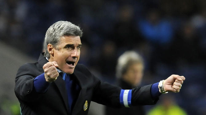 FC Porto's coach Luis Castro reacts towards his players against Benfica in a Portugal Cup semifinal first leg soccer match at the Dragao stadium in Porto, Portugal, Wednesday, March 26, 2014