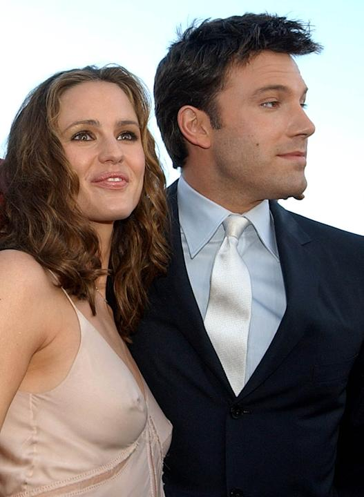 "FILE - In this Feb. 9, 2003 file photo, actors Jennifer Garner, left, and Ben Affleck pose at the premiere of their film, ""Daredevil,"" in Los Angeles. The couple have decided to divorce afte"