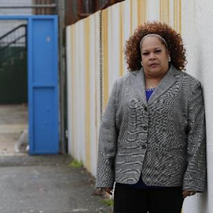 In this Thursday, April 23, 2015, photo Shalga Hightower, mother of  Iofemi Hightower, college student slain in 2007, poses for The Associated Press in the schoolyard where the murder happened in Newark, N.J. In the seven-plus years since her college-bound daughter's brutal slaying along with two friends in a case that became a national symbol of urban gun violence, Hightower has been on a mission. It started with a resolve to attend every court hearing involving the six men and boys eventually convicted for the crime, an odyssey that cost her her job and left her family temporarily homeless. Now, a documentary project is aiming to chronicle her struggles and her efforts on behalf of families of crime victims who are too often left to fend for themselves. (AP Photo/Julio Cortez)