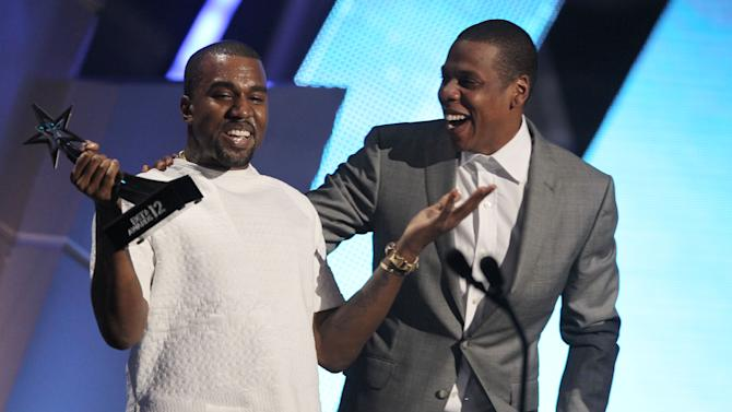 """Kanye West, left, and Jay-Z accept the award for best group for  """"The Throne"""" at the BET Awards on Sunday,  July 1, 2012, in Los Angeles. (Photo by Matt Sayles/Invision/AP)"""