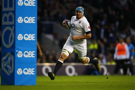 England's Morgan runs in to score a try against Argentina during their international rugby union match at Twickenham in London