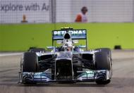 Mercedes Formula One driver Lewis Hamilton of Britain drives during the first practice session of the Singapore F1 Grand Prix at the Marina Bay street circuit in Singapore September 20, 2013. REUTERS/Natashia Lee