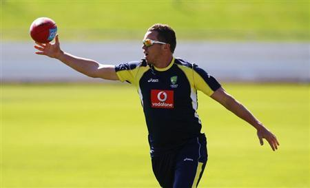 Australia's bowler Siddle catches a rugby ball during a practice session ahead of the second test cricket match against New Zealand in Hobart
