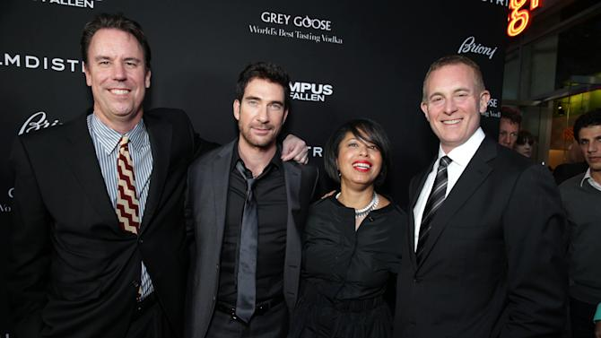 Millennium Films' Mark Gill, Dylan McDermott, FilmDistrict's Christine Birch and Executive Producer/FilmDistrict's Peter Schlessel at FilmDistrict's Premiere of 'Olympus Has Fallen' hosted by Brioni and Grey Goose at the ArcLight Hollywood, on Monday, March, 18, 2013 in Los Angeles. (Photo by Eric Charbonneau/Invision for FilmDistrict/AP Images)