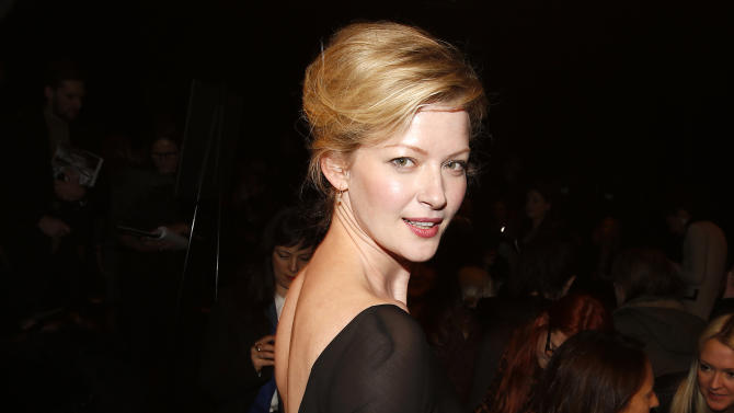 Actress Gretchen Mol arrives before the Donna Karan Autumn/Winter 2013 collection during New York Fashion Week in New York