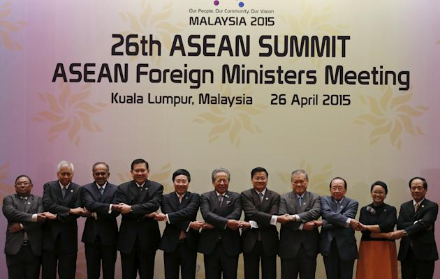 ASEAN Foreign Ministers pose for a photo at the Foreign Ministers Meeting during the 26th ASEAN Summit in Kuala Lumpur