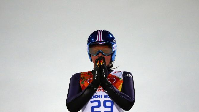 Winner Germany's Vogt reacts after her final jump in the women's ski jumping individual normal hill event of the Sochi 2014 Winter Olympic Games in Rosa Khutor