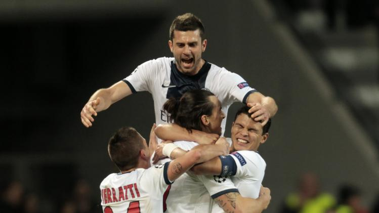 Paris St. Germain's Thiago Motta and team mates celebrate a goal against Bayer Leverkusen during their Champions League soccer match in Leverkusen