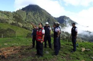 Red cross workers inspect a property on the slopes…