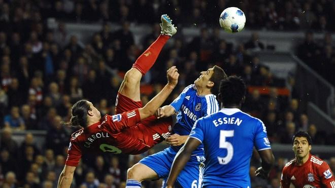 Liverpool's English Forward Andy Carroll (L) Vies AFP/Getty Images
