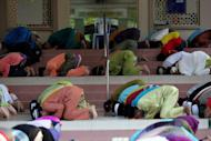 Malaysian Muslims offer prayers during Eid al-Fitr at a mosque in Kuala Lumpur on August 19, 2012. Malaysia has been rated the world's top Muslim-friendly holiday destination in a survey that listed Egypt, Turkey, United Arab Emirates, Saudi Arabia and Singapore as runners-up