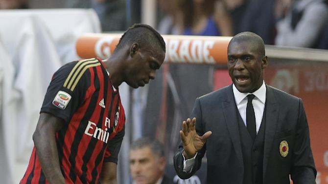 AC Milan coach Clarence Seedorf, of the Netherlands, talks to AC Milan forward Mario Balotelli during a Serie A soccer match between AC Milan and Parma, at the San Siro stadium in Milan, Italy, Sunday, March 16, 2014
