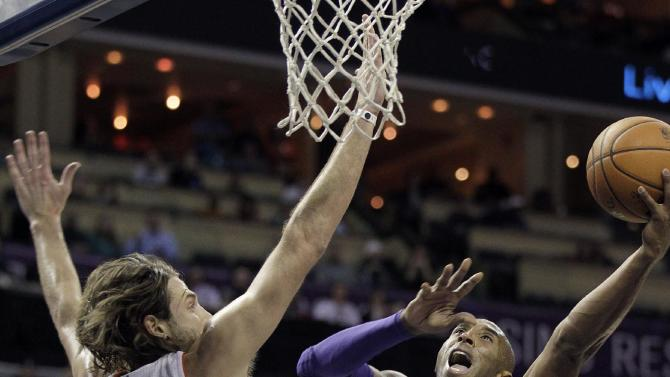 Charlotte Bobcats' Josh McRoberts (11) cannot block Los Angeles Lakers' Kobe Bryant's (24) shot close the the basket during the second half of an NBA basketball game in Charlotte, N.C., Saturday, Dec. 14, 2013. The Lakers won 88-85