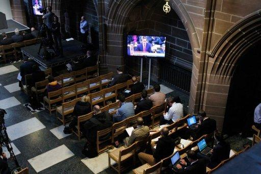 "British Prime Minister David Cameron's statement is watched on a television screen in Liverpool's Anglican Cathedral, on September 12, 2012, during a press conference for the release of unpublished papers by the Hillsborough Independent Panel. Cameron apologised Wednesday to the families of the 96 victims of the 1989 Hillsborough football stadium disaster for the ""double injustice"" they suffered."