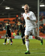 Connor Wickham wheels away after breaking the deadlock for England Under-21s at Blackpool