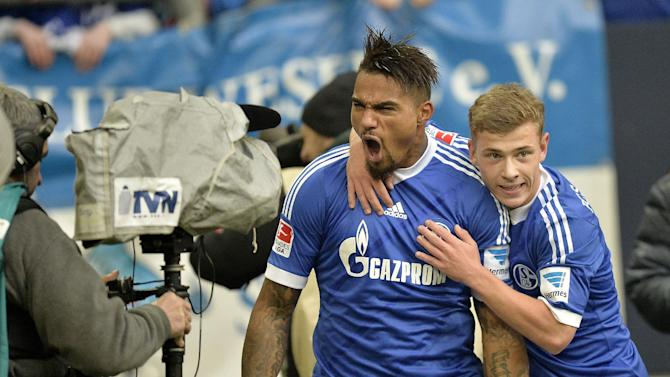 Schalke's Kevin-Prince Boateng of Ghana shouts into the camera after his team scored during the German Bundesliga soccer match between FC Schalke 04 and VfL Wolfsburg in Gelsenkirchen,  Germany, Saturday, Feb. 1, 2014. Boateng scored the winning goal, Schalke defeated Wolfsburg with 2-1