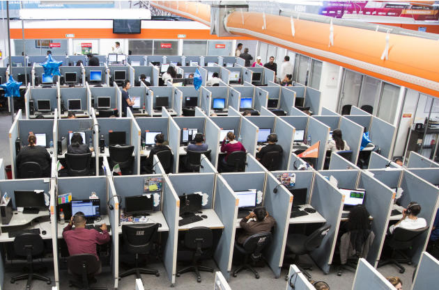 In this Aug. 13, 2014 photo, workers sit at desks at  Firstkontact Center, a call center in the northern border city of Tijuana, Mexico. If you're sitting in an office, you should probably read this s