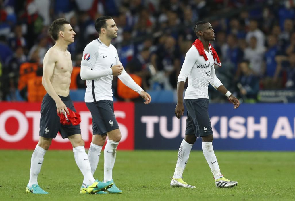 France's Laurent Koscielny, Adil Rami and Paul Pogba after the game