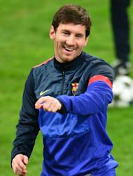 Lionel Messi trains with Barcelona on the eve of the UEFA Champions League match at AC Milan, on February 19, 2013. Barcelona hold a 12-point lead over Atletico Madrid at the top of La Liga in Spain