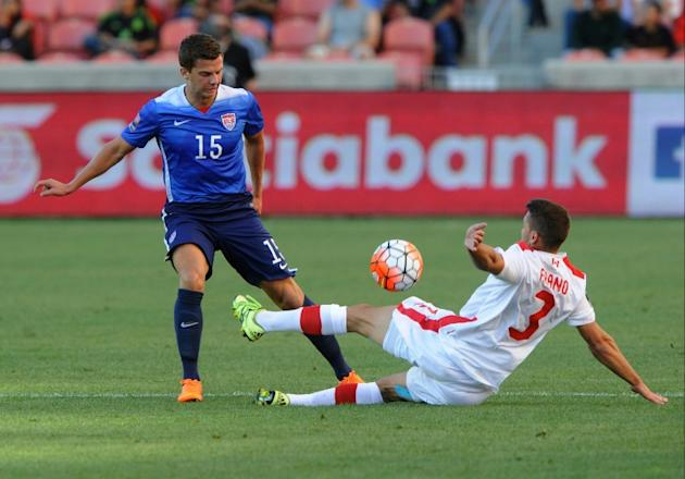Giuliano Frano (R) of Canada directs the ball away from Marc Pelosi of the US during the first half of the third place CONCACAF Olympic qualifying match, at Rio Tinto Stadium in Sandy, Utah, on Octobe