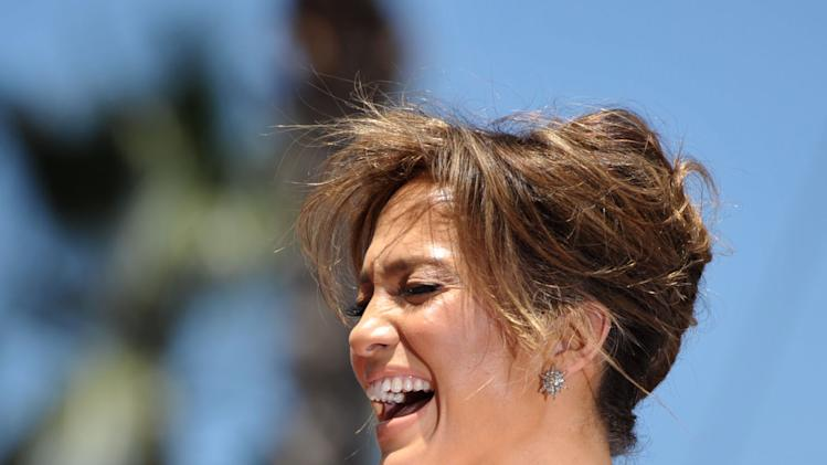 Jennifer Lopez reacts at a ceremony honoring her with a star on the Hollywood Walk of Fame on Thursday, June 20, 2013 in Los Angeles. (Photo by John Shearer/Invision/AP)