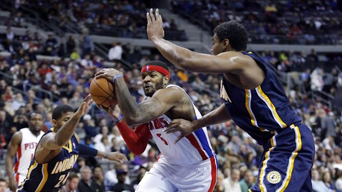 Detroit Pistons forward Josh Smith (6) drives to the basket against Indiana Pacers forward Paul George (24) and center Andrew Bynum, right, during the second half of an NBA basketball game Saturday, March 15, 2014, in Detroit. The Pacers defeated the Pistons 112-2104