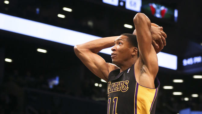 Los Angeles Lakers shooting guard Wesley Johnson (11) dunks the ball in the fourth quarter of an NBA basketball game against the Brooklyn Nets at the Barclays Center, Wednesday, Nov. 27, 2013, in New York. The Lakers defeated the Nets 99-94