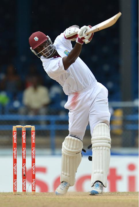 West Indies Darren Sammy launches a six