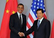 "US President Barack Obama shakes hands with Chinese President Hu Jintao before a bilateral meeting in Seoul. China has expressed ""serious concern"" to its ally North Korea about a planned rocket launch, a US official said after talks between Obama and Hu"