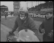 Watch footage from the Silverstone race track as nine times world motor cycling champion Mike Hailwood wins the Hutchinson 100 motorbike race.