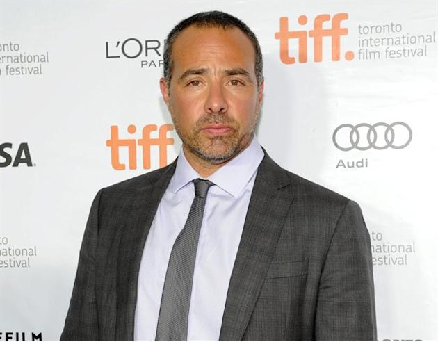 """FILE - In this Sept. 6, 2013 file photo, director Peter Landesman arrives at the premiere of """"Parkland"""" on day 2 of the Toronto International Film Festival at Roy Thomson Hall, in Toronto. A"""