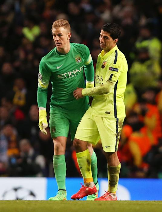 Football: Barcelona's Luis Suarez and Manchester City's Joe Hart at the end of the match