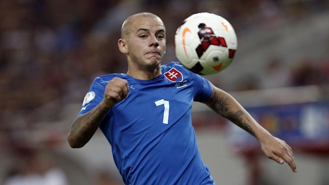 Slovakia's Vladimir Weiss tries to control the ball during a World Cup Group G qualifying soccer match against Greece at the Karaiskaki stadium in the port of Piraeus, near Athens, Friday, Oct. 11, 2013